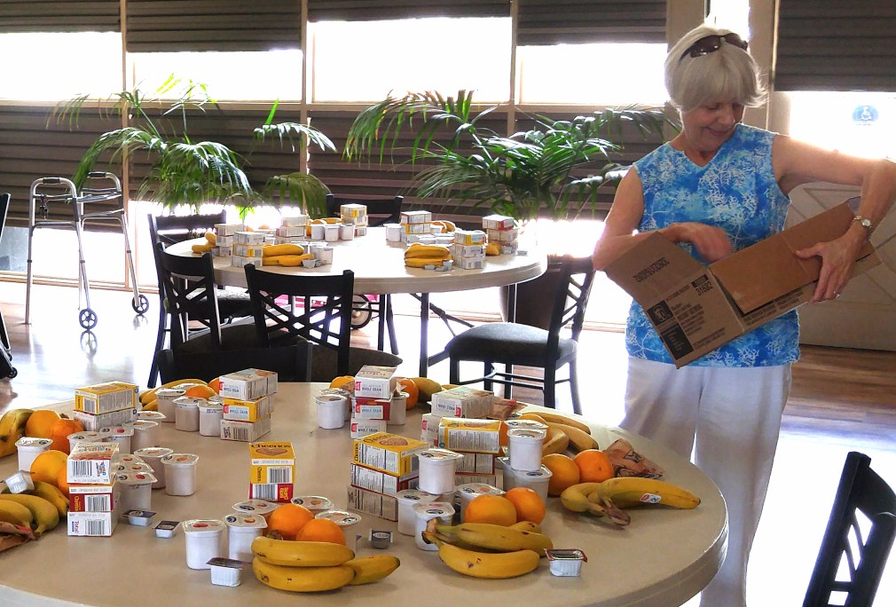 Volunteer Jan Shreve prepares weekend breakfast baskets