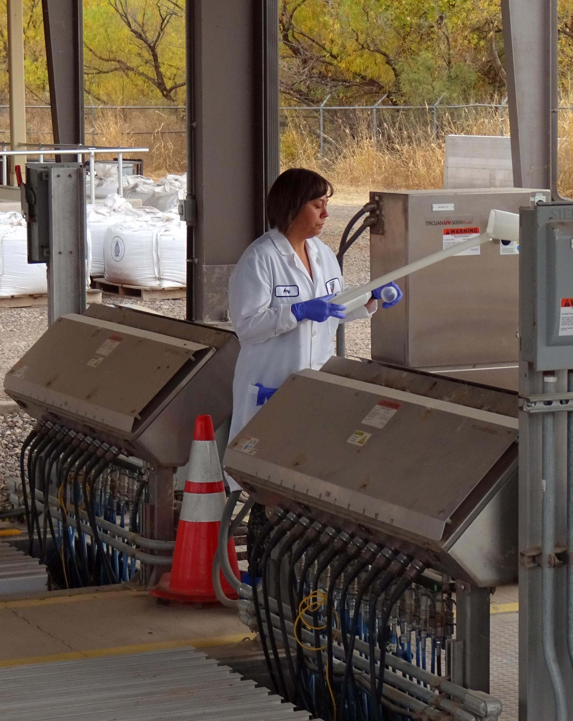 A lab technician collects samples at the facility.
